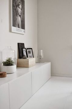 White with marble, blond wood. Via la cool & chic