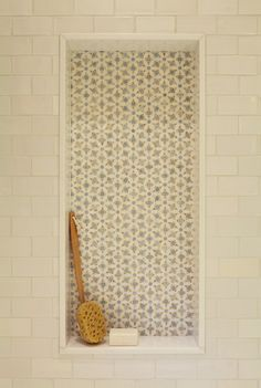 Girls bathroom renovation: white subway tile, Ken Mason handmade tile, Thassos marble niche surround, stone mosaic niche, daisy mosaic pattern. For more inspo, check out http://www.susancorrydesign.com