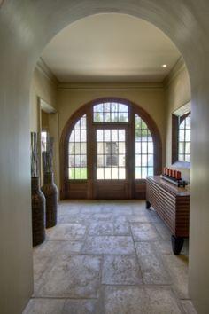 stone floor and arched front door echoed by arced inner hallway door/cieling Foyer Flooring, Stone Flooring, Kitchen Flooring, Floor Design, House Design, Arched Front Door, Interior Decorating, Interior Design, Stone Interior
