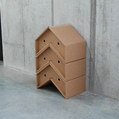 Otto - stackable cardboard chairs. These could be other material and possibly a bright rainbow stack or different woods, looking like an art piece.