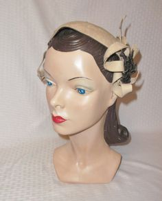 I;d re-work it without the bow.  1940's Vintage Half Hat with Bows from by MyVintageHatShop on Etsy