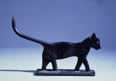 CAT BOOT SCRAPER, artist unidentified, c. 1900, cast iron, 11 3/8 x 17 1/2 x 3 in., American Folk Art Museum, gift of the museum's Friends Committee, 1979.22.1