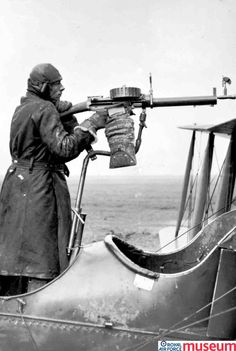 Experimental gun mounting.    This is a photograph of a Lewis Gun mounted on a Royal Aircraft Factory F.E.2d aircraft. This rather precarious mounting allowed for forward firing over the top of the aircraft's propeller arc.