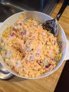 Paula deans corn salad! 2 cans of corn, one cup of mayonnaise, 1/2 cup chopped red onion, 1 cup of green bell pepper diced, 2 cups of shredded cheddar cheese and top it with crushed chili cheese Fritos!!!!