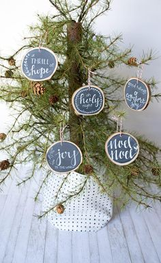 Rustic raw edge wood slice ornament, hand-lettered with your custom order. Strung with delicate red and white bakers twine. Each wood slice has been hand cut, by my dad and me, then dried to ensure no cracking or splitting. Each slice is hand-cut, hand-painted, then hand-lettered