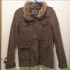 Levi's Utility Jacket Size: medium; faux fur lined; zips up with button snap closure; two front pockets with pull strings to cinch the waist Levi's Jackets & Coats Utility Jackets