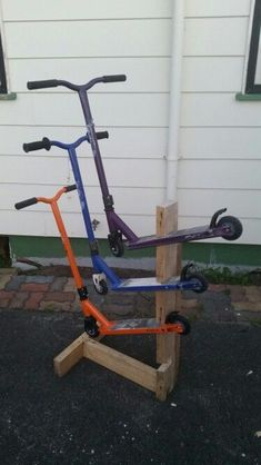 Scooter storage, little space saving idea. Thank you Rebel sports display for the idea. Scooter storage, little space saving idea. Thank you Rebel sports display for the idea. Garden Tool Storage, Shed Storage, Garage Storage, Toy Storage, Scooter Storage, Bicycle Storage, Small Garage, Diy Garage, Garage Ideas