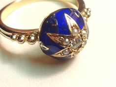 Antique 14k Estate Victorian Diamond & Seed Pearl Blue Enamel Fluer de lis Ring. by EstateVintTreasures on Etsy https://www.etsy.com/listing/117399707/antique-14k-estate-victorian-diamond