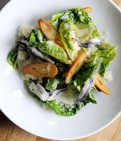 This classic Caesar salad recipe includes a recipe for making your own baguette, which isn't entirely necessary but will give it a touch of class. - by Tom Aikens