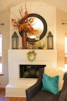 Pretty Fall Mantle. Love the tall vase