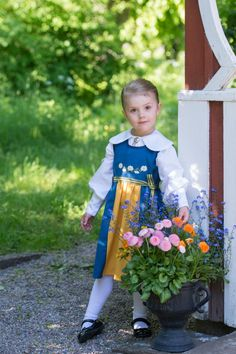 Princess Estelle looking cute in her national dress to mark Sweden's National Day which today is celebrated by all the Swedish royals.
