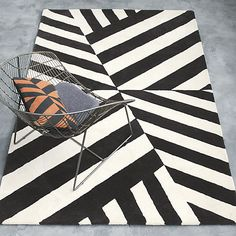 """<span class=""""copyHeader"""">alternative bands.</span> The Changes Rug was designed exclusively for CB2 in collaboration with Kravitz Design by Lenny Kravitz. Each piece is inspired by Lenny's eclectic global lifestyle and the furnishings from his homes in Paris, Brazil and the Bahamas. A collection that turns up the volume, the '70s-inspired designs capture the sleek glam of New York club culture and the natural ease of the California music scene.  Asymmetry and geometry align on the Changes…"""