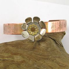 Copper Cuff Bracelet Flower and Stamped by HCJewelrybyRose on Etsy #handmade #jewelry #coppercuff  This is so pretty! I love copper cuffs!