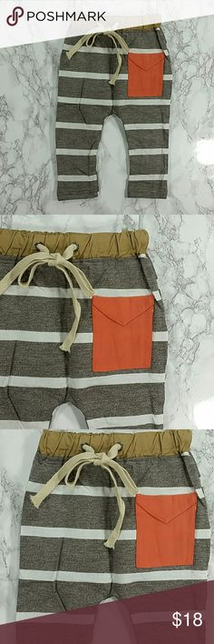 Heather Brown Jogger pants. Kids Adorable and comfortable Heather Brown Stripes and an orange pocket.  Pull up style  This item is brand new and never used.  #13733 Bottoms Sweatpants & Joggers
