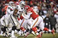 Kansas City Chiefs outside linebacker Tamba Hali (91), wearing a hand cast, rushed the passer while being blocked by Oakland Raiders offensive guard J'Marcus Webb (76) on Sunday, January 3, 2016 at Arrowhead Stadium in Kansas City, Mo. The Chiefs won, 23-17, for their tenth win in a row.