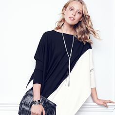 A dramatic shape and graphic colorblocking make this poncho a true statement piece. #seasonofstyle #WHBM