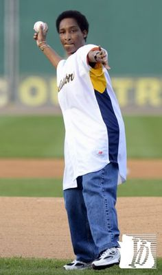 Special Olympics ambassador Loretta Claiborne throws out the first pitch during opening day at Sovereign Bank Stadium.