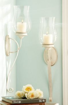 Iron hurricane pillar wall scones with a charming antique white finish will be a quaint addition to any wall. The sconces have a feel of times gone-by with a stylish design for today's home decor. Candles not included. Each sconce measures 5 W x Modern Wall Sconces, Candle Wall Sconces, Wall Sconce Lighting, Yellow Candles, Vintage Country, Country French, Country Style, Fireplace Wall, Fireplace Ideas