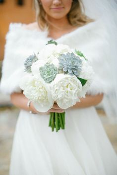 A perfect #bouquet for a sweet winter wedding. Photography: Kimberly Chau Photography - kimberlychau.com, Floral Design: Tamara Menges Designs - www.tamaramenges.com  Read More: http://www.stylemepretty.com/southwest-weddings/2014/04/30/elegant-winter-wedding/