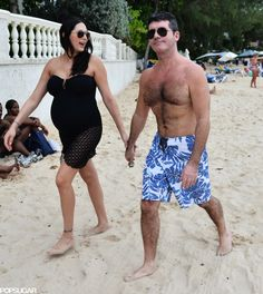 Simon Cowell and Lauren Silverman strolled in the Barbados sand during their Christmas 2013 holiday
