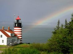 Lighthouse at the end of the rainbow. Coast of Maine.