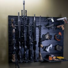 Build your ultimate gun wall or gun room with Hold Up Displays' wall gun racks and mounts. A modern and tactical choice for safely displaying and storing your rifles, handguns and accessories. Hidden Gun Storage, Weapon Storage, Gun Closet, Airsoft Guns, Tactical Guns, Supply Room, Gun Rooms, Slat Wall, Military Guns