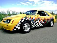 1985 Ford Mustang, that's quite a paint job, check out the interior!