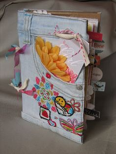 Album cover from an old pair of jeans. They can bring an old pair of jeans. They can also be creative in decorating it by using different types of materials.Perfect for Teens. Journal cover from old jeans.use a pocket from Dave's jeans for our memo