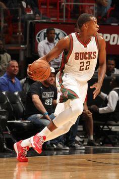 Khris Middleton  22 of the Milwaukee Bucks drives to the basket against the  Miami Heat 84a82462e