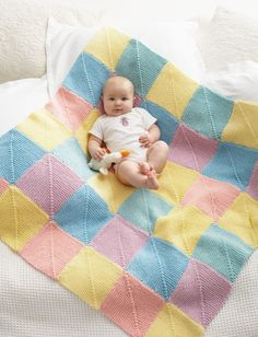 Perfect for bubbly little ones, this Baby Giggles Afghan is the quintessential baby blanket knit pattern: it& colorful, cozy and easy to make. Made with 36 knit motif patterns, this blanket blends five creamy pastels into one finished piece. Knitted Afghans, Knitted Baby Blankets, Baby Afghans, Baby Knitting Patterns, Baby Patterns, Free Knitting, Blanket Patterns, Crochet Patterns, Knitting Ideas