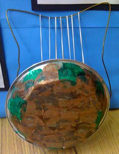 crafts/ You can make a lyre like this one with a coat hanger, rubber bands (or yarn) and a metal bowl (or alu. pie pan). Really the strings should run over the top of the bowl, so that the bowl will work as a resonator to make the music sound louder when you pluck the strings.