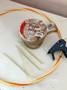 You won't believe she made this from a hula hoop! Here's how to create a lovely nautical wreath for your front door or interior mirror using a hula hoop and jute rope. It's the perfect DIY coastal decor for your home year-round! - This hometalk DIY article has been shared as a blogger affiliate link #ad #beachwreath #summerwreath #DIYsummerwreath
