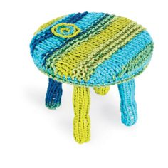 Foot stool yarn bombed by K Witta for Michaels Stores. Click here for How to Yarn Bomb video.
