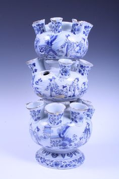 Rare early eighteenth century English Delft blue and white tin glazed pottery three-stage tulip vase with painted chinoiserie figure decoration, with multiple spouts, on circular splayed foot, 44cm high