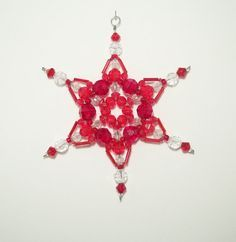 Snowflake Ornament - Suncatcher - Decoration- Red and Clear. via Etsy.