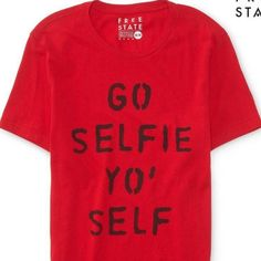 "Go Selfie Yo Self Red Shirt Aeropostale Free State Selfie Graphic T.  Sure, sometimes you're guilty of having #NoFilter, but you're just being candid like this Free State Selfie Graphic T! The stenciled text reads ""Go Selfie Yo' Self"" for a cheeky look that'll promote you to class clown. Pair it with your craziest shades, and photobomb as many pics. Imported. 100% cotton.Machine wash/dry. Cotton graphic red t-shirt. ❌ trade or pp Aeropostale Tops"
