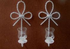 Home Interiors Wall Sconces Nautical Knot Candle Holders White Set of 2  This great pair of sconces is made by Home Interiors in a glossy white over heavy metal rope that resembles a nautical or shabby chic look. This set includes small peg votives that will hold tealites or small votives. Measurements are 12.5 inches long, 6 inches in width, and extend 5 inches from the wall. These are being sold in a set of two.