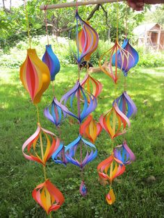 paper mobiles I made for bco craft swap. the recipient was a really cute 4-year old who loves rainbows! i love how these turned out, this was lots of fun!!