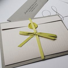 @Patti B Murphy's photo, wedding invites, smoke and mist gray with lime green wax seal and ribbon  #letterpress #waxseal