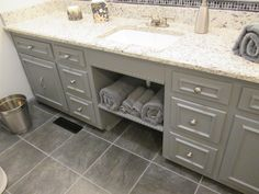 Remodeled our bathroom--painted the existing cabinets gray & added brushed nickel hardware along with a light gray granite vanity top.