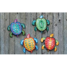 Sea Turtles Wall Art  Set of 4 These bright coloredsea turtles are a delightful accent to any beach themed room. �12