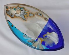 """Colorful fused glass by artist Linda Humphrey.   Two Birds  5""""x9""""x4"""". Multi process fused and slumped glass.  Coldworked on lap grinder.  Pointed oval dish. ©Linda Humphrey / KilnForms."""