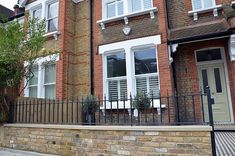 Front Garden Company brick wall metal rails black white Victorian mosaic York stone Balham Clapham Wandsworth Earsfield