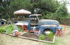 """This 1953 Chevy truck took on a new life as a backyard """"playscape."""" It even holds a barbecue pit under the hood!"""