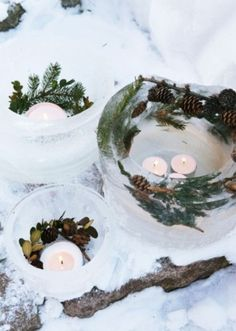 Frozen candle holders!  Looks like they filled a large container with water and holiday elements, then added a smaller can in the center to create the cavity for the tea lights.
