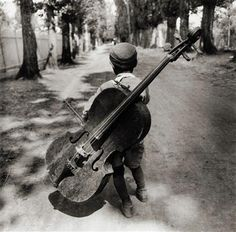 """""""The cello is the most perfect instrument aside from the human voice. --- Gypsy boy with cello, Hungary, Eva Besnyö. Black White Photos, Black And White Photography, Expositions, Vintage Photographs, Photos Vintage, Old Photos, Street Photography, Cello Photography, Photography Kids"""