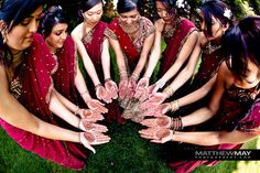 Indian wedding bridesmaids red sari 1 I like the Mehndi designs on their hands!