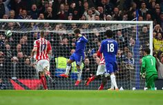 Eden Hazard Photos - Eden Hazard of Chelsea celebrates scoring his penalty during the Barclays Premier League match between Chelsea and Stoke City at Stamford Bridge on April 4, 2015 in London, England. - Chelsea v Stoke City - Premier League