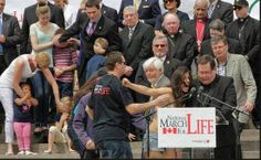 Topless Protester Interrupts Cardinal reading Pope Francis message at March for Life Canada http://jceworld.blogspot.ca/2014/05/topless-protester-interrupts-cardinal.html