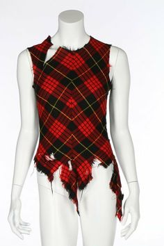 * Alexander McQueen tartan bodice, made for the stylist Katy England, 'Highland Rape' collection, Autumn-Winter, 1995-6, of carefully matched and joined bias-cut panels of McQueen clan tartan with slash to neck, ragged and torn pointed front hem and sheer black net back